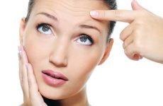 Жировик на лобі: причини та симптоми, методи видалення і народні засоби