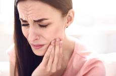 Точковий масаж при зубному болі: опис технік, акупунктура
