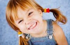 Жовтий наліт на зубах у дитини: причини появи та профілактика