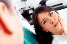 Болить зуб мудрості при вагітності: що робити?